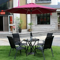 Outdoor furniture of table and chairs with umbrella