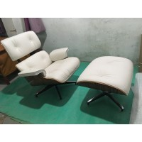 Off White Eames style lounge chair and ottoman in Italian leather and Rosewood veneer