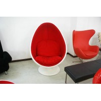 Pod chair in white shell with red fabric interior